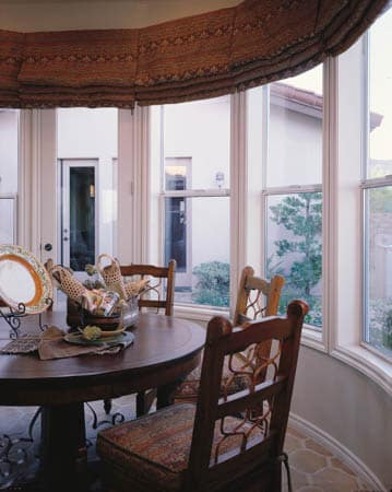 Aluminum Windows - A dining room table in front of a window - Window