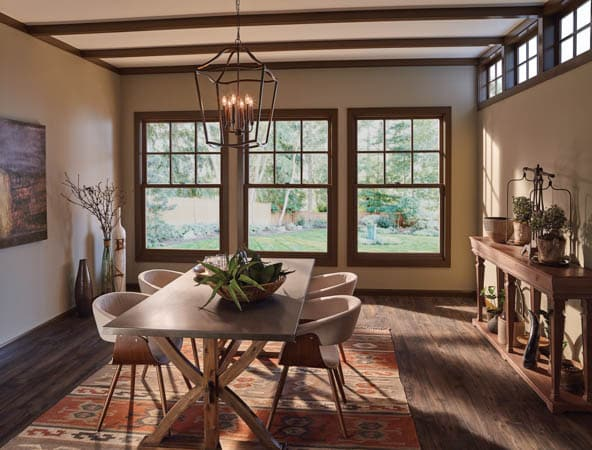 Clad Wood Windows - A living room filled with furniture and a large window - Window